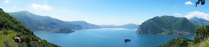 Amazing panoramic from `Monte Isola` with Lake Iseo. Italian landscape. Island on lake. View from the island Monte Isola on Lake I. Seo, Italy Royalty Free Stock Photos
