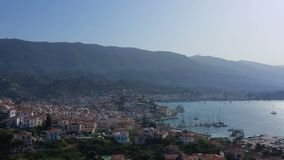 Amazing panoramic view of Porose Greece. Sunny day in Greek island. Aerial video 4K footage. Flyig with birds stock video