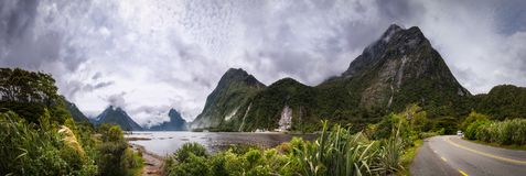 Adventure Travel at Milford Sound. Amazing Panoramic View when you arrive at Milford Sound - An Adventure Holiday in New Zealand in Fiordland National Park in stock photo
