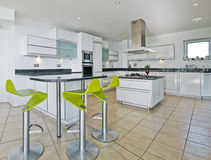 Amazing penthouse kitchen. Amazing modern penthouse kitchen with breakfast bar Royalty Free Stock Images