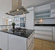 Amazing penthouse kitchen. Amazing modern penthouse kitchen with breakfast bar Stock Photos
