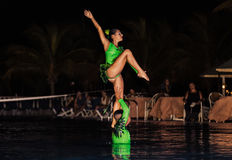 Amazing performance of hotel entertainment team at night beautiful water show Stock Photos