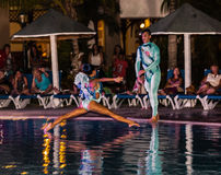 Amazing performance of hotel entertainment team at night spectacular water show Royalty Free Stock Photo