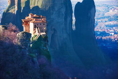 Amazing photo of the Holy Rousanou Monastery. In Greece built on the steep cliff with Meteora mountains and Kalabaka on background Stock Photos
