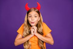 Amazing. Photo Of Pretty Little Lady Headband Horns On Head Overjoyed Look At Helloween Party Decorations Wear Orange T- Stock Photo