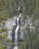 Beautiful Alaskan Forested Mountain Waterfall. Amazing photo of a truly stunning forested Alaskan waterfall. Shot in summer as the water is flowing strong Stock Image