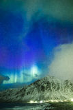 Amazing Picturesque Unique Nothern Lights Aurora Borealis Over Lofoten. Islands in Nothern Part of Norway. Over the Polar Circle. Vertical Image Composition Stock Image