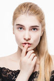 Amazing portrait of a beautiful young woman blond hair with perfect skin closeup Stock Photo