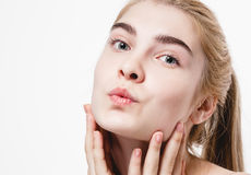 Amazing portrait of a beautiful young woman blond hair with perfect skin closeup Stock Image