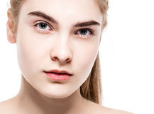 Amazing portrait of a beautiful young woman blond hair with perfect skin closeup Stock Photos