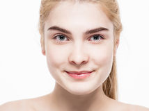 Amazing portrait of a beautiful young woman blond hair with perfect skin closeup Stock Photography