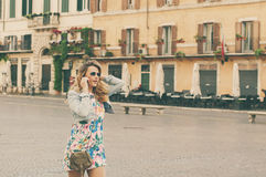 Amazing pretty woman talking on her mobile phone in piazza Navon Royalty Free Stock Photo