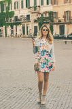 Amazing pretty woman talking on her mobile phone in piazza Navon Stock Photos