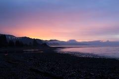 Amazing Purple and Orange Sunrise Colours. Vivid purple and orange sunrise colours on Vancouver Island Royalty Free Stock Photography