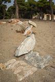 Amazing pyramid of stones on the beach in Schinias, Attica, Gree Stock Image