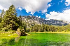 Amazing real green color of Mountains lake,  landscape stock photography