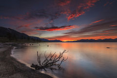 Amazing red sunset over a  lake. Royalty Free Stock Image