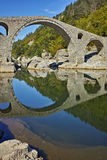 Amazing Reflection of Devil's Bridge in Arda river, Bulgaria Royalty Free Stock Image
