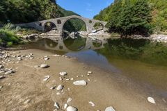Amazing Reflection of Devil`s Bridge in Arda river and Rhodopes mountain, Bulgaria. Amazing Reflection of Devil`s Bridge in Arda river and Rhodopes mountain Royalty Free Stock Image