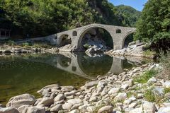 Amazing Reflection of Devil`s Bridge in Arda river and Rhodopes mountain, Bulgaria. Amazing Reflection of Devil`s Bridge in Arda river and Rhodopes mountain Stock Image