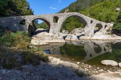 Amazing Reflection of Devil`s Bridge in Arda river and Rhodopes mountain, Bulgaria. Amazing Reflection of Devil`s Bridge in Arda river and Rhodopes mountain Stock Photography