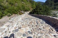 Amazing Reflection of Devil`s Bridge in Arda river and Rhodopes mountain, Bulgaria. Amazing Reflection of Devil`s Bridge in Arda river and Rhodopes mountain Stock Photos