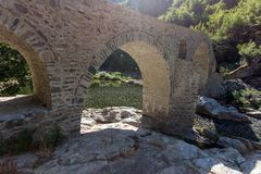 Amazing Reflection of Devil`s Bridge in Arda river and Rhodopes mountain, Bulgaria. Amazing Reflection of Devil`s Bridge in Arda river and Rhodopes mountain Royalty Free Stock Photos