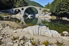 Amazing Reflection of Devil's Bridge in Arda river and Rhodopes mountain, Bulgaria Stock Image