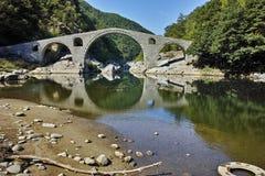 Amazing Reflection of Devil's Bridge in Arda river and Rhodopes mountain, Bulgaria Stock Image