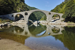 Amazing Reflection of Devil's Bridge in Arda river and Rhodopes mountain, Bulgaria Royalty Free Stock Images