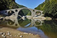Amazing Reflection of Devil's Bridge in Arda river and Rhodopes mountain, Bulgaria Royalty Free Stock Photos