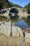 Amazing Reflection of The Devil's Bridge in Arda river and Rhodopes mountain, Bulgaria Royalty Free Stock Photo