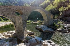 Amazing Reflection of Devil`s Bridge in Arda river and Rhodopes mountain, Bulgaria. Amazing Reflection of Devil`s Bridge in Arda river and Rhodopes mountain Royalty Free Stock Photo