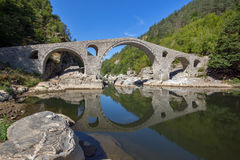 Amazing Reflection of Devil& x27;s Bridge in Arda river,  Bulgaria Royalty Free Stock Photography