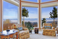 Amazing rich interior with stunning window view on mountains Stock Image