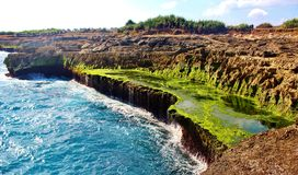 Beside devil& x27;s tear. Amazing rock formation beside the more popular rock formation devil& x27;s tear in Nusa lembongan bali Indonesia. Still ponds Royalty Free Stock Images