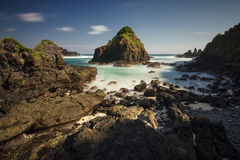 The amazing rock in the  southern sea Lombok with long exposure and blue sky Stock Photo