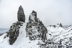 Amazing rocks covered by snow and ice