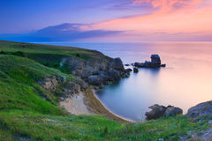 Amazing rocky coastline at sunset Royalty Free Stock Photography