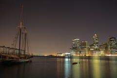 Amazing sailing ship is against Manhattan Island New York USA Stock Photos