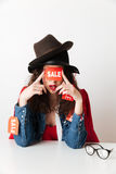 Amazing sale shopping lady wearing sale signs covering eyes Stock Photography