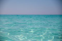 Amazing sandy beach against the cloudless sky. Beautyful sandy beach against the cloudless sky and pure water Royalty Free Stock Photography