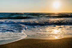 Amazing sandy beach with sea and  clouds, Corfu Royalty Free Stock Photo