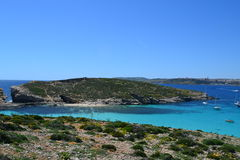 Amazing scene of the Blue Lagoon in Comino Malta. Beautiful View and Crystal Clear Water in the Blue Lagoon in Comino between Malta and Gozo Royalty Free Stock Photo