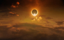 Amazing scientific background - total solar eclipse. In dark red glowing sky, mysterious natural phenomenon when Moon passes between planet Earth and Sun royalty free stock image