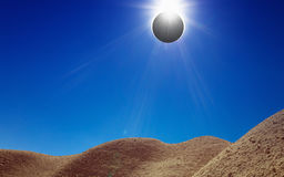 Amazing scientific background - total solar eclipse in desert Royalty Free Stock Photo