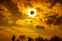 Scientific natural phenomenon. Total solar eclipse with diamond. Amazing scientific natural phenomenon. The Moon covering the Sun. Silhouette of man admire the Royalty Free Stock Photos