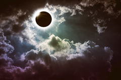 Amazing scientific natural phenomenon. Total solar eclipse glowing on sky. Amazing scientific natural phenomenon. Total solar eclipse glowing on sky with dark royalty free stock photo
