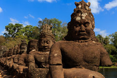 Amazing Sculpture at South Gate of Angkor Thom Stock Image