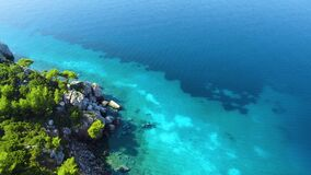 Amazing sea coast with different blue azure shades. Aerial view of exotic sea